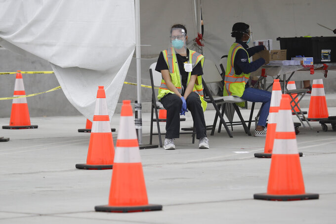 Samples are cataloged at a mobile Coronavirus testing site at the Charles Drew University of Medicine and Science Wednesday, July 22, 2020, in Los Angeles. California's confirmed coronavirus cases have topped 409,000, surpassing New York for most in the nation. (AP Photo/Marcio Jose Sanchez)