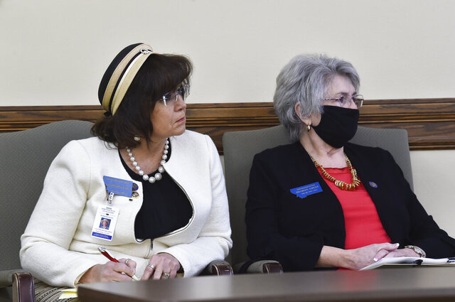 State Reps. Lola Sheldon-Galloway, R-Great Falls, left, and Sharon Greef, R-Florence, listen to testimony in the House Judiciary Committee at the State Capitol, Tuesday, Jan. 19, 2021, in Helena, Mont. (Thom Bridge/Independent Record via AP)