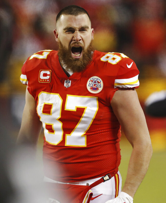 Kansas City Chiefs tight end Travis Kelce shouts on the sideline during the second half of the AFC Championship NFL football game against the New England Patriots, Sunday, Jan. 20, 2019, in Kansas City, Mo. (AP Photo/Charlie Neibergall)