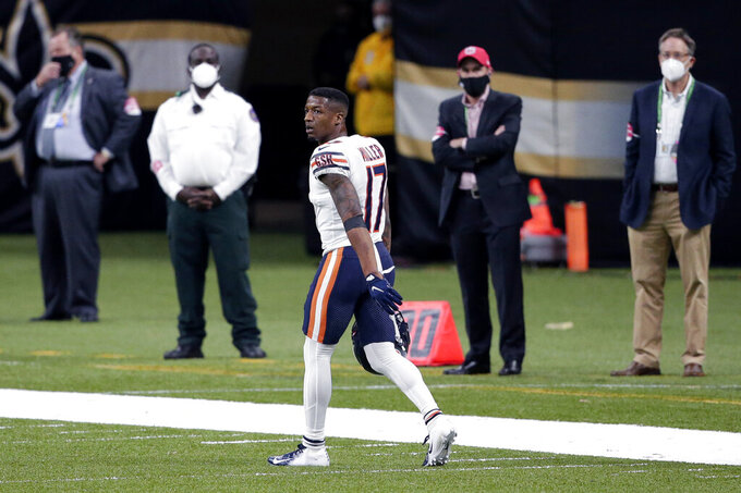 Chicago Bears wide receiver Anthony Miller (17) walks off the field after being ejected for unsportsmanlike conduct in the second half of an NFL wild-card playoff football game against the New Orleans Saints in New Orleans, Sunday, Jan. 10, 2021. (AP Photo/Butch Dill)