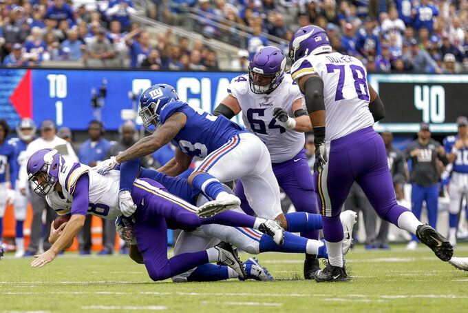New York Giants defensive tackle Dexter Lawrence (97) and linebacker Oshane Ximines (53) sack Minnesota Vikings quarterback Kirk Cousins (8) during the second quarter of an NFL football game, Sunday, Oct. 6, 2019, in East Rutherford, N.J. (AP Photo/Adam Hunger)
