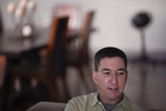 In this July 10, 2019 photo, U.S. journalist Glenn Greenwald speaks during an interview at his home in Rio de Janeiro, Brazil. A conservative website reported that federal police have requested financial regulators to investigate Greenwald's finances, weeks after publishing explosive reports about a key member of Brazil's far-right government. (AP Photo/Leo Correa)