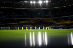 FILE - Players observe a moment of silence for the victims of the COVID-19 pandemic before the Europa League round of 16 soccer match between Inter Milan and Getafe at the Veltins-Arena in Gelsenkirchen, Germany, in this Wednesday, Aug. 5, 2020, file photo. (Ina Fassbender, Pool Photo via AP, File)