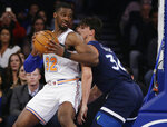 New York Knicks' Noah Vonleh (32) is defended by Minnesota Timberwolves' Dario Saric (36) during the first half of an NBA basketball game Friday, Feb. 22, 2019, in New York. (AP Photo/Frank Franklin II)