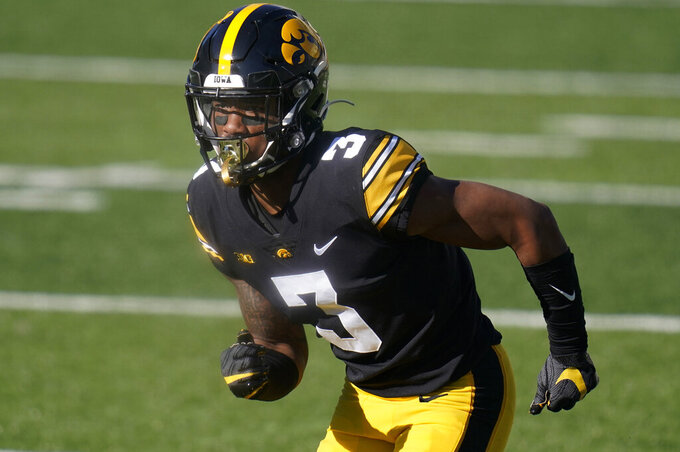 """FILE - In this Saturday, Nov. 7, 2020 file photo, Iowa wide receiver Tyrone Tracy Jr. runs on the field during an NCAA college football game against Michigan State in Iowa City, Iowa. It was back in the 2019 season when Tyrone Tracy Jr., gave himself the nickname """"Sweet Feet."""" Never mind that Tracy was just a redshirt freshman in Iowa's experienced wide receiver group. He came up with it, he said that season, so it was his. Two years later, he said he's keeping it.(AP Photo/Charlie Neibergall, File)"""