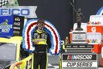Ryan Blaney celebrates in Victory Lane after winning a NASCAR Cup Series auto race at Talladega Superspeedway in Talladega Ala., Monday, June 22, 2020. (AP Photo/John Bazemore)