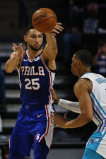 Philadelphia 76ers guard Ben Simmons, left, passes around Charlotte Hornets forward Miles Bridges in the second half of a preseason NBA basketball game in Winston-Salem, N.C., Friday, Oct. 11, 2019. (AP Photo/Nell Redmond)