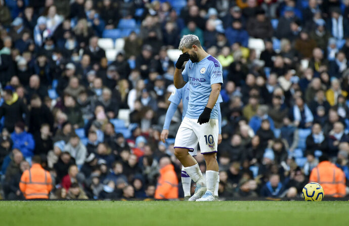 Manchester City's Sergio Aguero reacts after Crystal Palace's Cenk Tosun scoring his side's opening goal during the English Premier League soccer match between Manchester City and Crystal Palace at Etihad stadium in Manchester, England, Saturday, Jan. 18, 2020. (AP Photo/Rui Vieira)