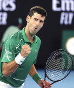 Serbia's Novak Djokovic reacts after winning a point against Germany's Jan-Lennard Struff at the Australian Open tennis championship in Melbourne, Australia, Monday, Jan. 20, 2020. (AP Photo/Lee Jin-man)
