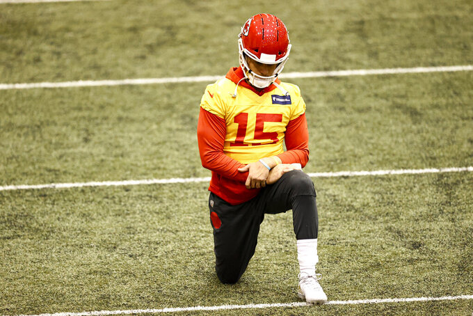 Kansas City Chiefs Quarterback Patrick Mahomes (15) stretching during NFL football practice Thursday, Feb. 4, 2021, in Kansas City, Mo. The Chiefs will face the Tampa Bay Buccaneers in Super Bowl 55. (Steve Sanders/Kansas City Chiefs via AP)