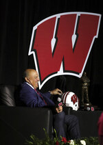 University of Wisconsin Athletic Director Barry Alvarez shares a light moment during an event marking his retirement announcement at the Kohl Center in Madison, Wis. Tuesday, April 6, 2021. (John Hart/Wisconsin State Journal via AP)