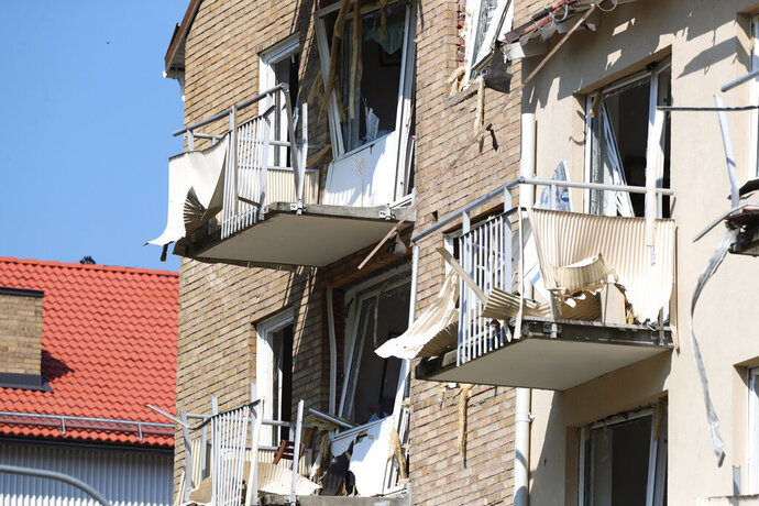 A view of damaged balconies and windows at a block of flats that were hit by an explosion, in Linkoping, Sweden, Friday,  June 7, 2019. A blast ripped through two adjacent apartment buildings in a southern Sweden city on Friday, police said. There were unconfirmed reports of people with minor injuries. (Jeppe Gustafsson/TT News Agency via AP)
