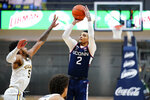 Connecticut's James Bouknight (2) goes up for a shot against Villanova's Justin Moore (5) during the second half of an NCAA college basketball game, Saturday, Feb. 20, 2021, in Villanova, Pa. (AP Photo/Matt Slocum)