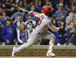 St. Louis Cardinals' Marcell Ozuna hits a solo home run against the Chicago Cubs during the ninth inning of a baseball game Sunday, May 5, 2019, in Chicago. The Chicago Cubs won 13-5. (AP Photo/Nam Y. Huh)