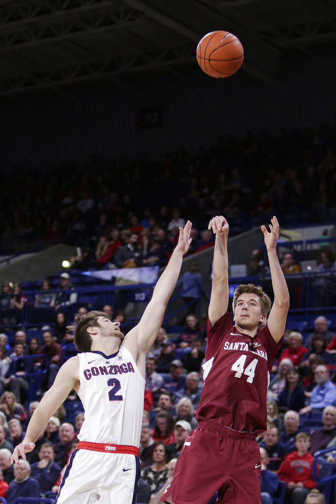 Santa Clara guard Max Dorward (44) shoots while defended by Gonzaga guard Jack Beach (2) during the second half of an NCAA college basketball game in Spokane, Wash., Saturday, Jan. 5, 2019. (AP Photo/Young Kwak)