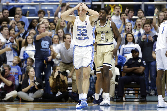 North Carolina guard Justin Pierce (32) reacts following a play against Georgia Tech during the second half of an NCAA college basketball game in Chapel Hill, N.C., Saturday, Jan. 4, 2020. (AP Photo/Gerry Broome)