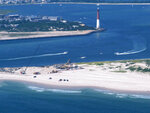 This July 11, 2014 aerial photo shows the Barnegat Inlet in Barnegat Light, N.J. The inlet is included in a $16 billion flood control plan that would build storm gates that could slam shut across the waterway, a proposal on which the government is seeking public input. (AP Photo/Wayne Parry)