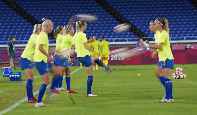 Sweden's players warm up before a women's semifinal soccer match against Australia at the 2020 Summer Olympics, Monday, Aug. 2, 2021, in Yokohama, Japan. (AP Photo/Kiichiro Sato)during a women's semifinal soccer match at the 2020 Summer Olympics, Monday, Aug. 2, 2021, in Yokohama, Japan. (AP Photo/Kiichiro Sato)