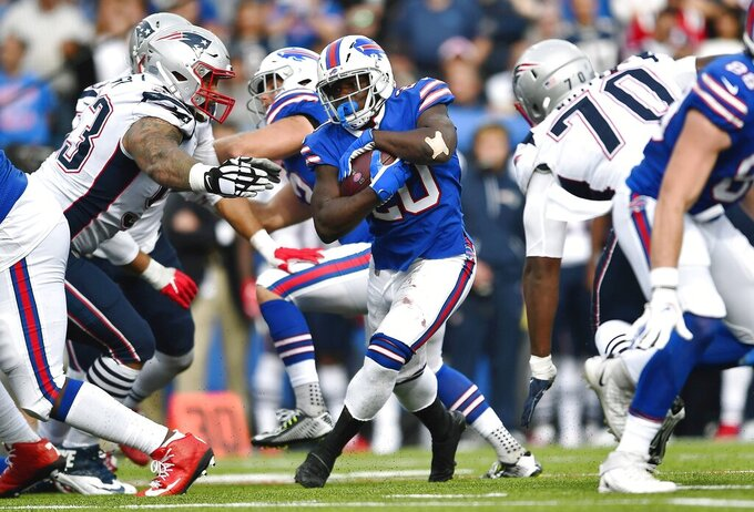 Buffalo Bills running back Frank Gore, center, carries the ball against the New England Patriots in the second half of an NFL football game, Sunday, Sept. 29, 2019, in Orchard Park, N.Y. (AP Photo/Adrian Kraus)