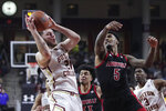 Boston College forward Nik Popovic (21) grabs a rebound next to Louisville forward Malik Williams (5) during the first half of an NCAA college basketball game in Boston, Wednesday, Jan. 29, 2020. (AP Photo/Charles Krupa)