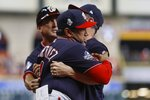 Washington Nationals manager Dave Martinez has to be restrained after being ejected for arguing an interference call during the seventh inning of Game 6 of the baseball World Series against the Houston Astros Tuesday, Oct. 29, 2019, in Houston. (AP Photo/Matt Slocum)