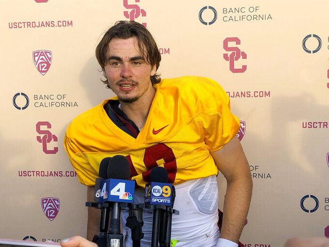 Southern California quarterback J.T. Daniels speaks to reporters following his first NCAA college football practice after winning the Trojans' starting job, Tuesday, Aug. 28, 2018, in Los Angeles. The 18-year-old Daniels will be the first true freshman to start at quarterback for USC's powerhouse program since 2009. (AP Photo/Greg Beacham)