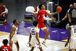 Texas Tech guard Terrence Shannon Jr. (1) drives to the basket past LSU guard Eric Gaines (25) in the second half of an NCAA college basketball game in Baton Rouge, La., Saturday, Jan. 30, 2021. Texas Tech won 76-71. (AP Photo/Tyler Kaufman)