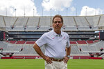 FILE - In this Aug. 3, 2019, file photo, Alabama head coach Nick Saban prepares for a team coach photo prior to Alabama's fall camp fan-day NCAA college football scrimmage at Bryant-Denny Stadium in Tuscaloosa, Ala. This is the time of year when the Southeastern Conference usually validates its claim as the best league in college football by dominating neutral-site nonconference matchups. The SEC is 21-6 in regular-season nonconference games against Power Five opponents at neutral sites since 2012. (AP Photo/Vasha Hunt, File)