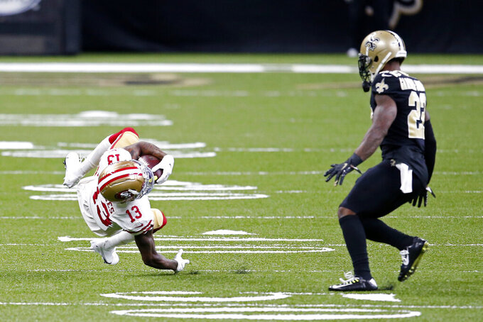 San Francisco 49ers wide receiver Richie James (13) pulls in a reception in front of New Orleans Saints safety Chauncey Gardner-Johnson (22) in the first half of an NFL football game in New Orleans, Sunday, Nov. 15, 2020. (AP Photo/Butch Dill)