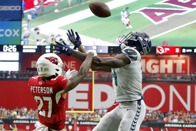 Arizona Cardinals cornerback Kevin Peterson (27) breaks up a pass intended for Seattle Seahawks wide receiver D.K. Metcalf during the first half of an NFL football game, Sunday, Sept. 29, 2019, in Glendale, Ariz. (AP Photo/Ross D. Franklin)