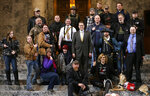 FILE - In this Jan. 15, 2015, file photo, Washington state Rep. Matt Shea, R-Spokane Valley, in suit and yellow tie at center, poses for a group photo with gun owners inside the Capitol in Olympia, Wash., following a gun-rights rally. The mayor and police chief of Spokane, Wash., are the latest to demand that the conservative state legislator resign from office after leaked emails revealed he sought to conduct surveillance on local progressive leaders. Mayor David Condon and Police Chief Craig Meidl on Tuesday, Aug. 20, 2019 denounced Shea, who wants to create a 51st state based on Christian principles.(AP Photo/Ted S. Warren, File)