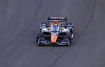 Arrow McLaren SP driver Pato O'Ward (5) heads toward the finish line during qualifying for an IndyCar auto race at Indianapolis Motor Speedway, Friday, Aug. 13, 2021, in Indianapolis. (AP Photo/Doug McSchooler)