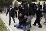 Israeli police arrests aPalestinian at al Aqsa mosque compound in Jerusalem, Monday, Feb. 18, 2019. Israeli police officers have arrested several Palestinians for