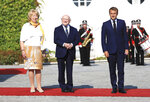 President of Ireland Michael D. Higgins, second left, and his wife Sabina Coyne, pose for a photo with French President Emmanuel Macron, at Aras an Uachtarain, in Dublin,  Thursday, Aug. 26, 2021, during his first official visit to Ireland.  (AP Photo/Peter Morrison)