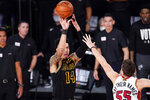 Los Angeles Lakers guard Danny Green shoots over Miami Heat guard Duncan Robinson during the second half in Game 5 of basketball's NBA Finals Friday, Oct. 9, 2020, in Lake Buena Vista, Fla. (AP Photo/Mark J. Terrill)