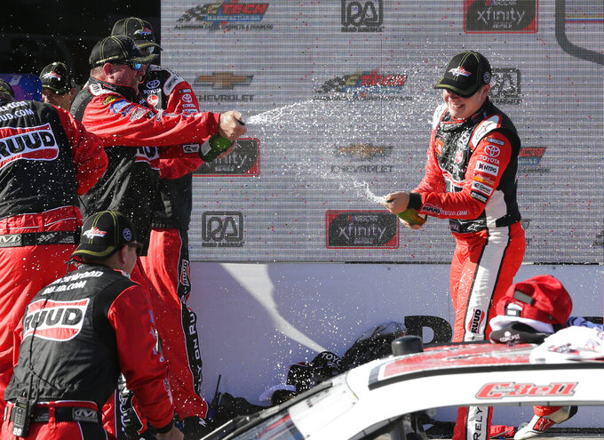 Christopher Bell, right, celebrates with his team in Victory Lane after he won the NASCAR Xfinity Series auto race Saturday, Aug. 24, 2019, at Road America in Elkhart Lake, Wis. (Gary C. Klein/The Sheboygan Press via AP)