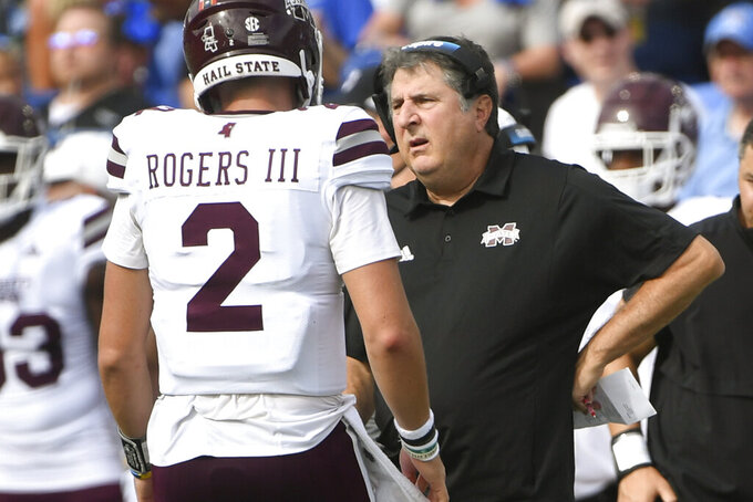 Mississippi State coach Mike Leach, right, talks to Mississippi State quarterback Will Rogers during the first half of an NCAA college football game against Memphis, Saturday, Sept. 18, 2021, in Memphis, Tenn. (AP Photo/John Amis)