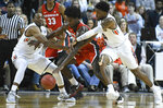 Auburn center Austin Wiley (50) and Auburn player Malik Dunbar (4) attempt to disrupt Georgia forward Rayshaun Hammonds (20) during the first half of an NCAA college basketball game Saturday, Jan. 12, 2019, in Auburn, Ala. (AP Photo/Julie Bennett)