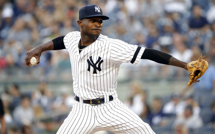 New York Yankees' Domingo German delivers a pitch during the first inning of a baseball game against the Toronto Blue Jays, Friday, July 12, 2019, in New York. (AP Photo/Frank Franklin II)
