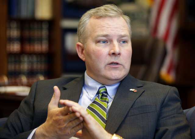 FILE - In this Jan. 16, 2015, file photo, Arkansas Lt. Gov. Tim Griffin is interviewed in his office at the Arkansas state Capitol in Little Rock, Ark. An independent panel has approved raises for all 135 members of the Arkansas General Assembly and the state's seven constitutional officers for a total of more than $150,000 combined in payroll increases. Griffin, asked the commission not to increase his salary at all. Even so, the panel unanimously approved his pay raise.