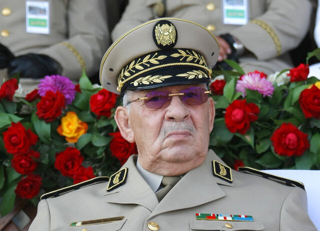 FILE - In this Sunday, July 1, 2018 file picture Algeria's army chief Gen. Ahmed Gaid Salah presides a military parade in Algiers. Algerian state media says the country's powerful military chief Gen. Ahmed Gaid Salah has died. (AP Photo/Anis Belghoul, File)