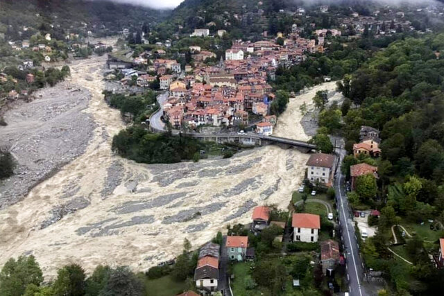 This aerial view provided Sunday Oct.4, 2020 by the Alpes Maritimes region fire brigade show a house keeping a fragile balance on a hill while a rive floods Saturday Oct.3. 2020 near La Vesubie, southern France. French authorities deployed about 1,000 firefighters, four military helicopters and troops to search for at least eight people who were missing after devastating floods hit a mountainous border region with Italy, where at least four people were killed. (SDIS 06 via AP)