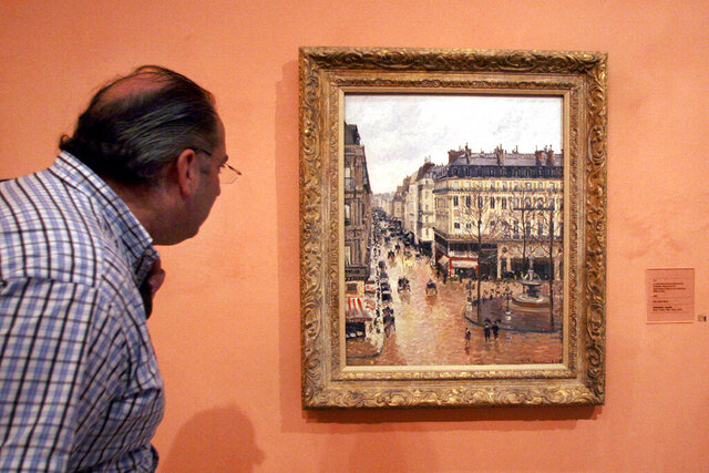 FILE - This May 12, 2005 file photo shows a visitor viewing the Impressionist painting called