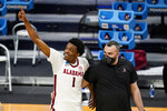 Alabama forward Herbert Jones (1) waves to fans as he leaves the court following a first-round game against Iona in the NCAA men's college basketball tournament at Hinkle Fieldhouse in Indianapolis, Saturday, March 20, 2021. Alabama defeated Iona 68-55. (AP Photo/Michael Conroy)