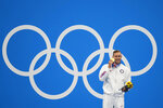 Caeleb Dressel, of United States, poses after winning the gold medal in the men's 50-meter freestyle final at the 2020 Summer Olympics, Sunday, Aug. 1, 2021, in Tokyo, Japan. (AP Photo/David Goldman)