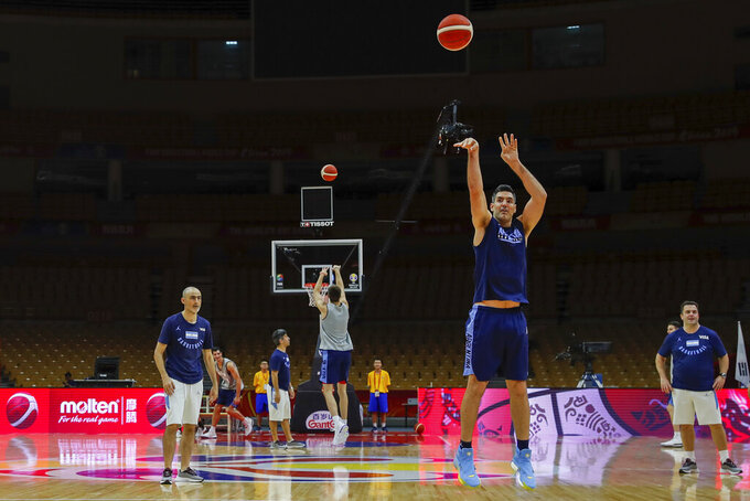 Members of the Argentina basketball team shoot free throws during practice at the Wuhan Sport Center ahead of the FIBA Basketball World Cup, in Wuhan in central China's Hubei province, Friday, Aug. 30, 2019. The competition, which features 32 teams from around the globe, will be held in 8 cities across China starting on Saturday. (AP Photo/Andy Wong)