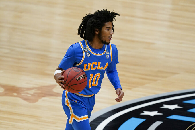 UCLA guard Tyger Campbell (10) drives up court during the second half of a men's Final Four NCAA college basketball tournament semifinal game against Gonzaga, Saturday, April 3, 2021, at Lucas Oil Stadium in Indianapolis. (AP Photo/Darron Cummings)