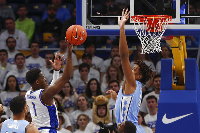 Pittsburgh's Xavier Johnson (1) shoots over North Carolina's Armando Bacot (5) during the first half of an NCAA college basketball game, Saturday, Jan. 18, 2020, in Pittsburgh. (AP Photo/Keith Srakocic)