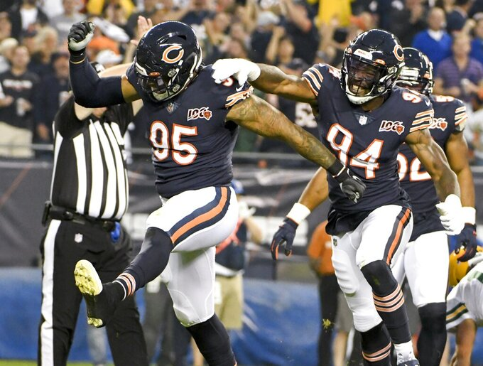 Chicago Bears' Roy Robertson-Harris reacts after sacking Green Bay Packers' Aaron Rodgers during the first half of an NFL football game Thursday, Sept. 5, 2019, in Chicago. (AP Photo/David Banks)