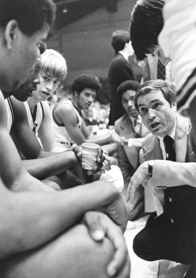 In this Feb. 28, 1976, file photo, Wake Forest basketball coach Carl Tacy talks to his players during an NCAA college basketball game against North Carolina State. Tacy, the Former Wake Forest and Marshall basketball coach, died died early Thursday, April 2, 2020. He was 87. (The Winston-Salem Journal via AP)